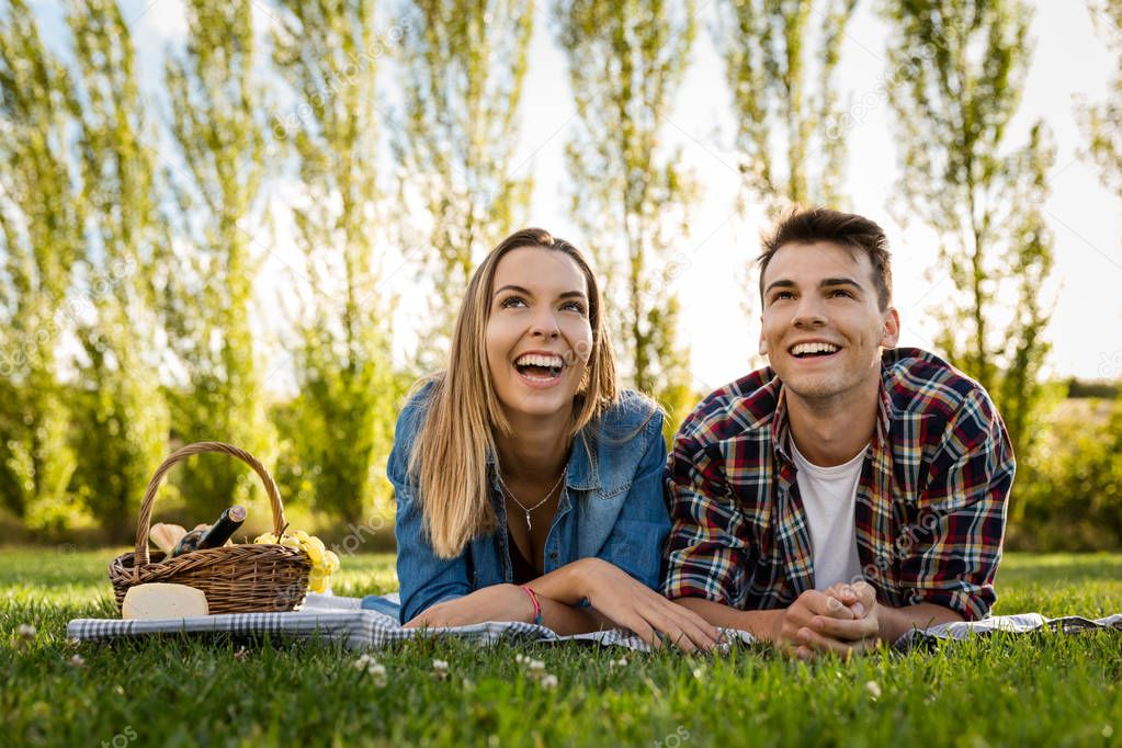 beautiful couple making picnic
