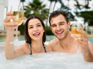 Young couple in jacuzzi