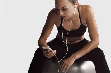 woman setting the music playlist