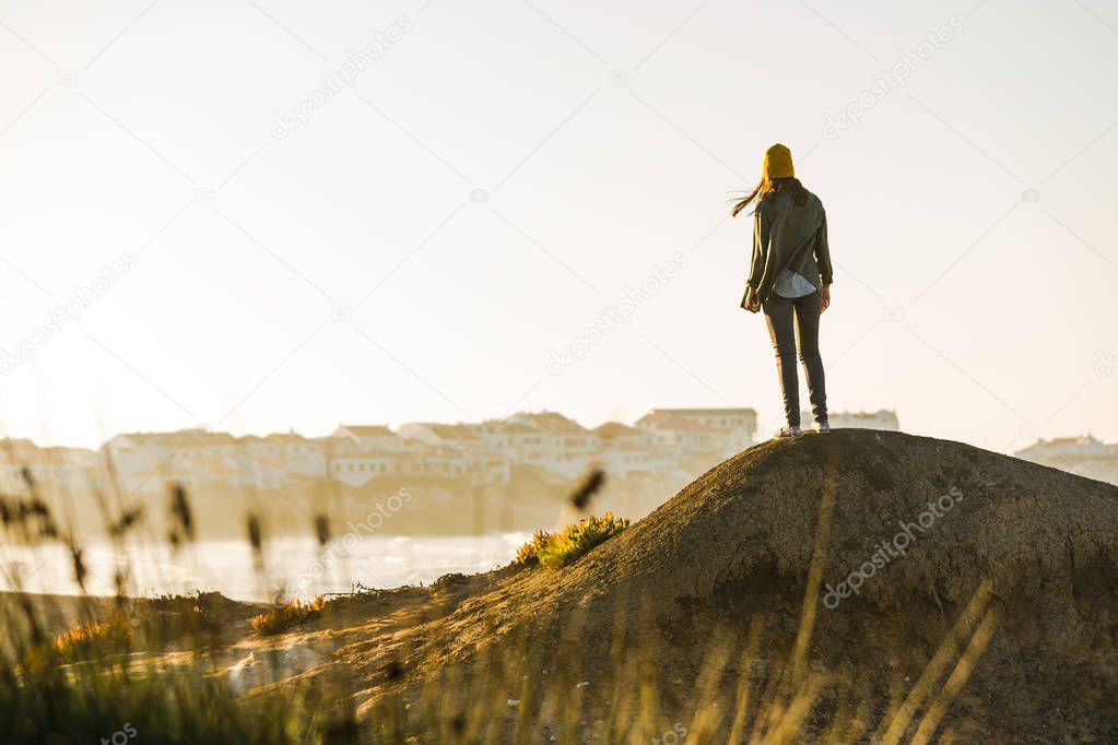 Woman walking over cliff