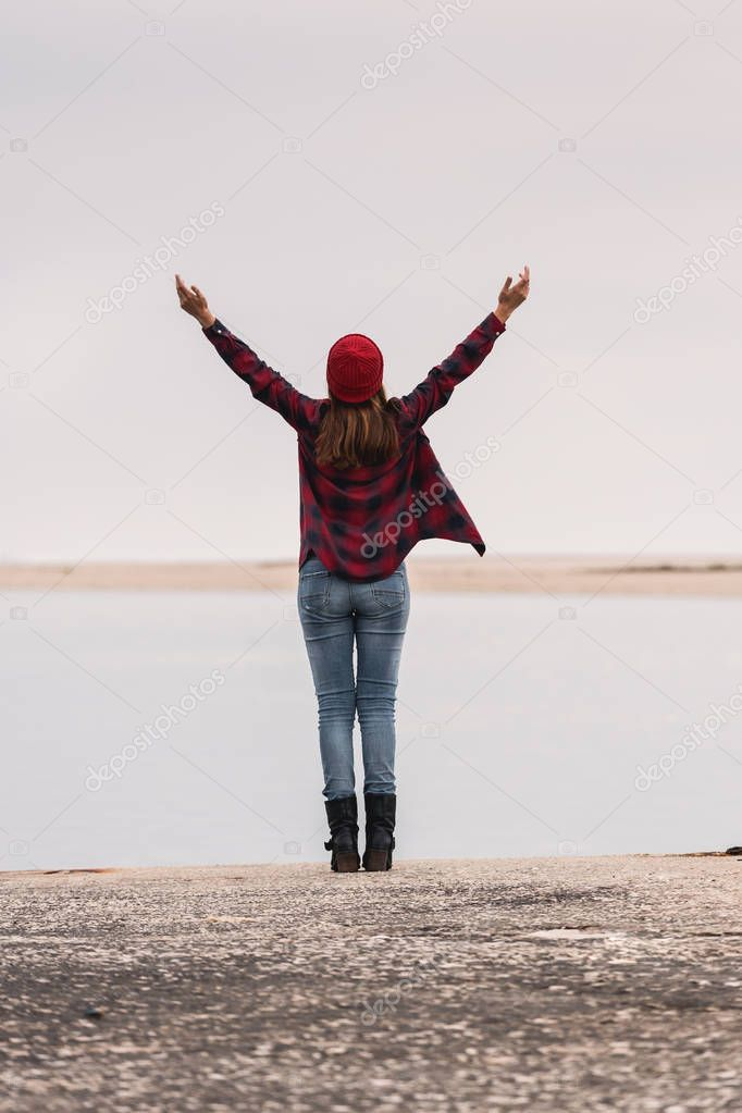 Beautiful woman standing on pier