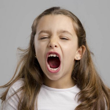 little girl with open mouth