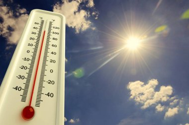 Heat, thermometer shows the temperature is hot in the sky, Summer