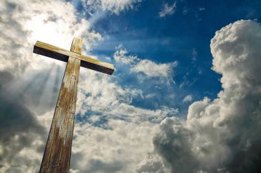Cross against the sky. Happy Easter. Christian symbol
