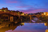 The Puente de San Martin in Toledo, Spain, before sunrise