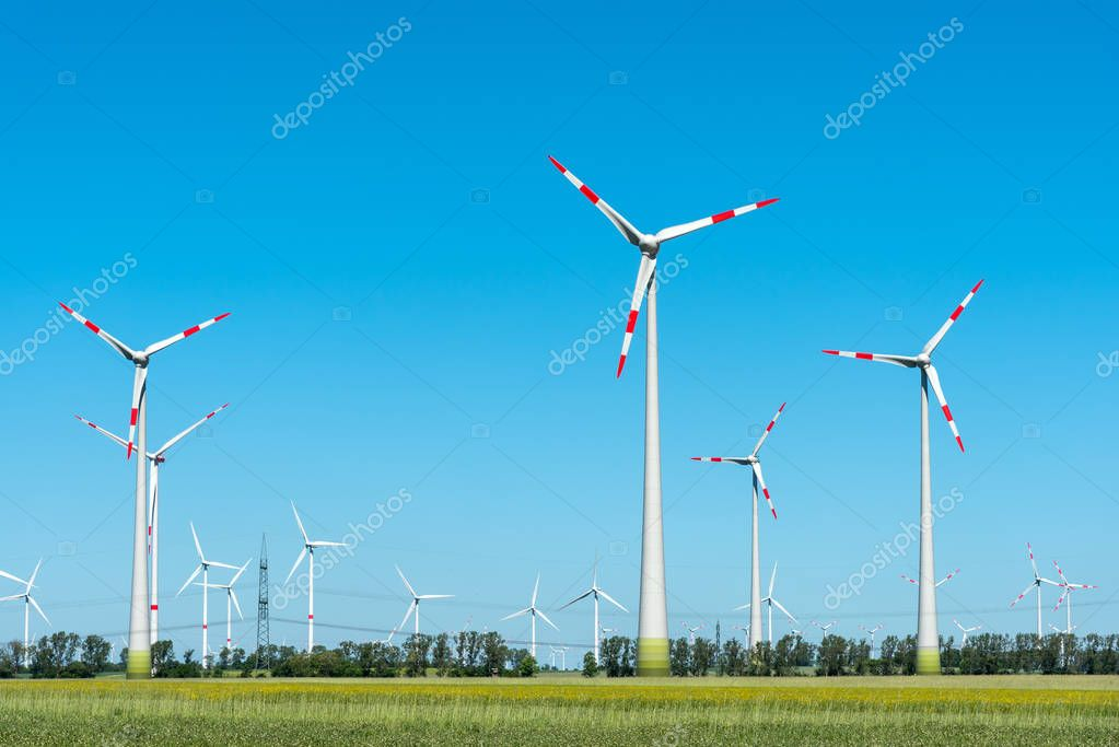 Modern wind turbines on a sunny day seen in Germany