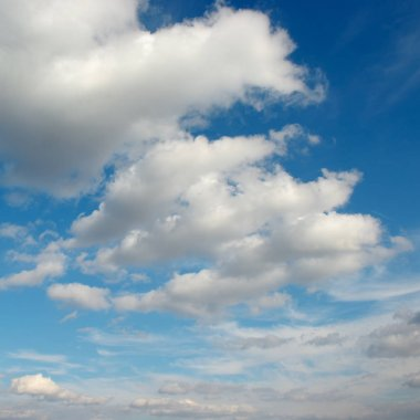Cirrus clouds in the blue sky. Beautiful natural background.