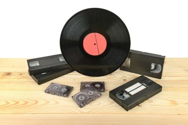 Composition of vinyl disc, audiocassettes and videocassettes on