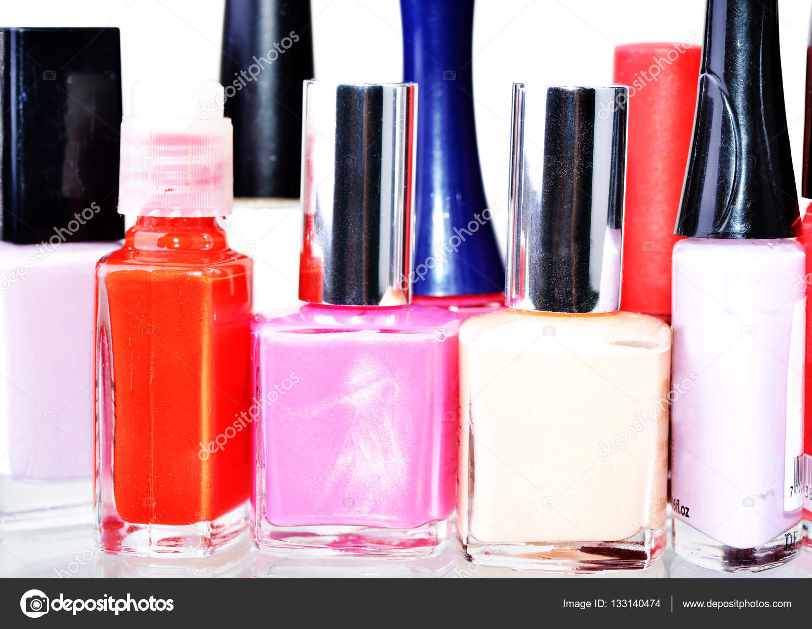 Macro shot of several nail paint bottles over white — Stock Photo ...