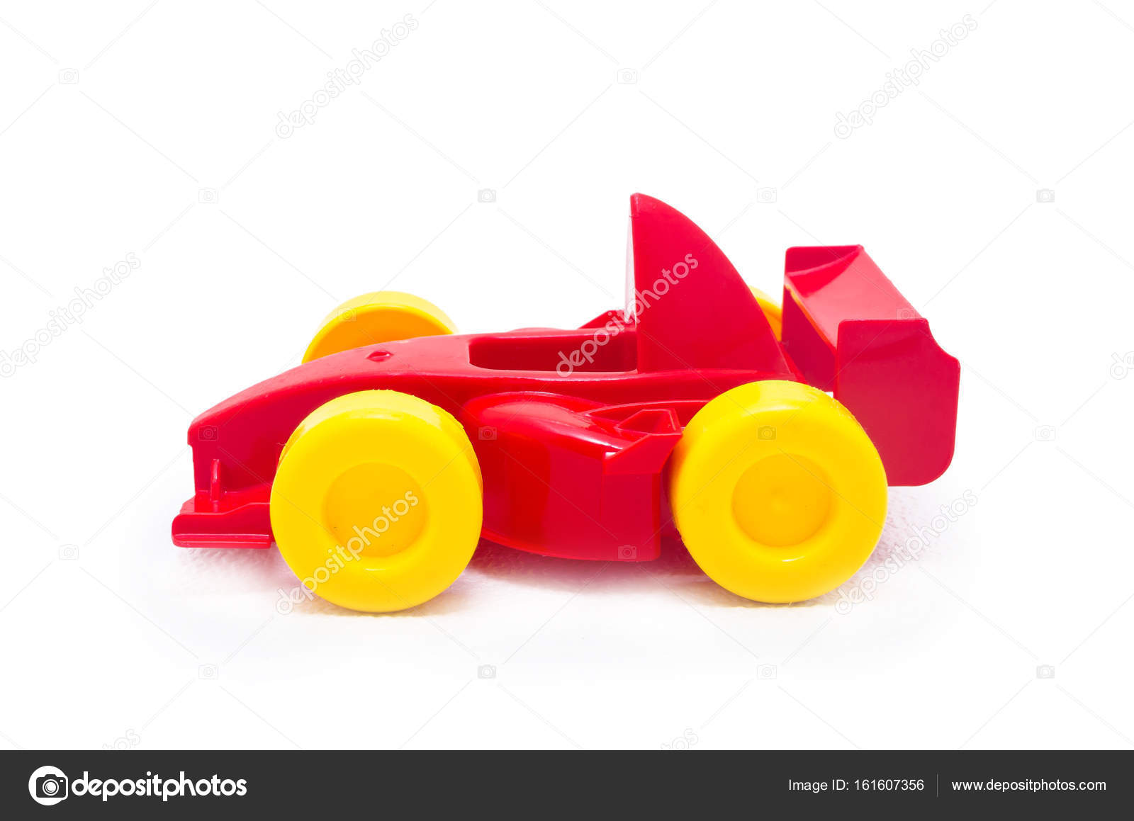 Plastic Red Racing Toy Car Toy With Yellow Wheels Stock Photo