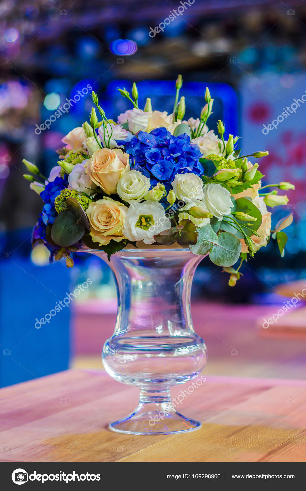 Beautiful flower arrangement bouquet of blue hydrangea orchid beautiful flower arrangement bouquet of blue hydrangea orchid and rose in a glass vase on a table in a restaurant photo by dudaeva izmirmasajfo
