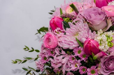 Delicate fresh bouquet of fresh flowers with pink Ranunculus, ro