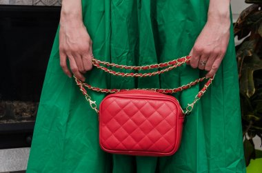 stylish woman of fashionable woman has a small quilted red leath