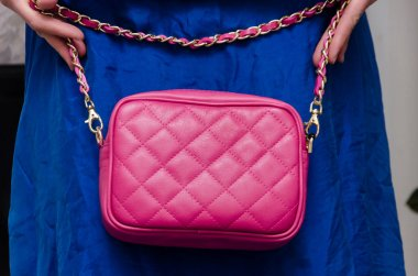 stylish woman of fashionable woman has a small quilted pink leat