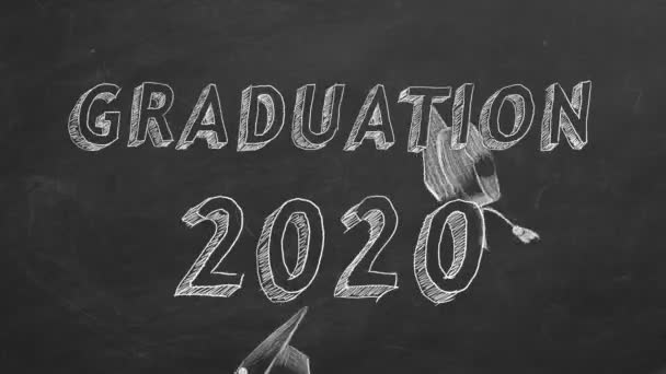 Hand drawing Graduation 2020 and graduation caps on blackboard