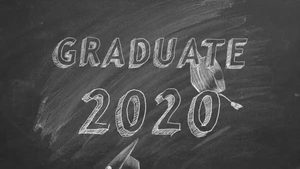 Hand drawing Graduate 2020 and graduation caps on blackboard