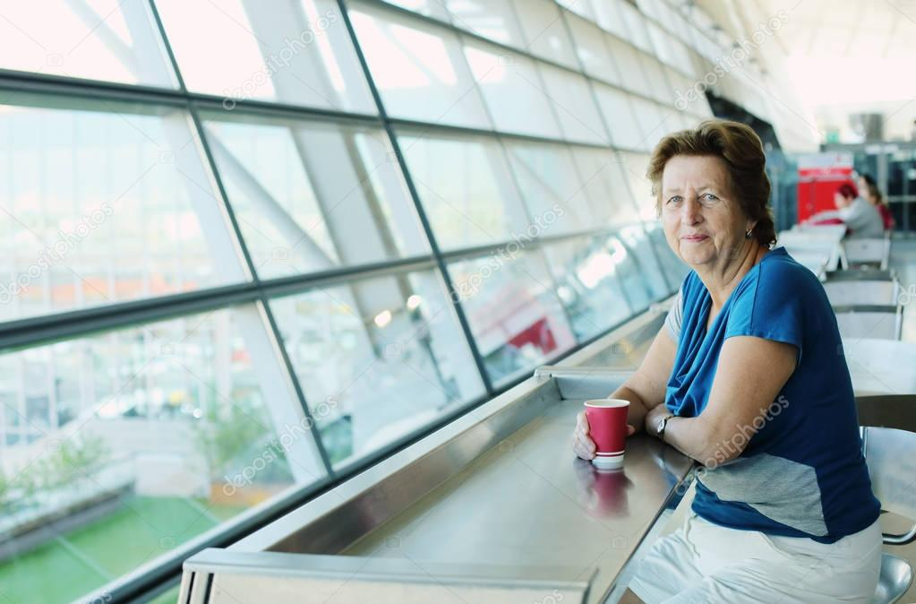 woman sitting in the airport