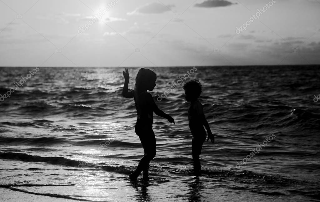 kids playing on the beach