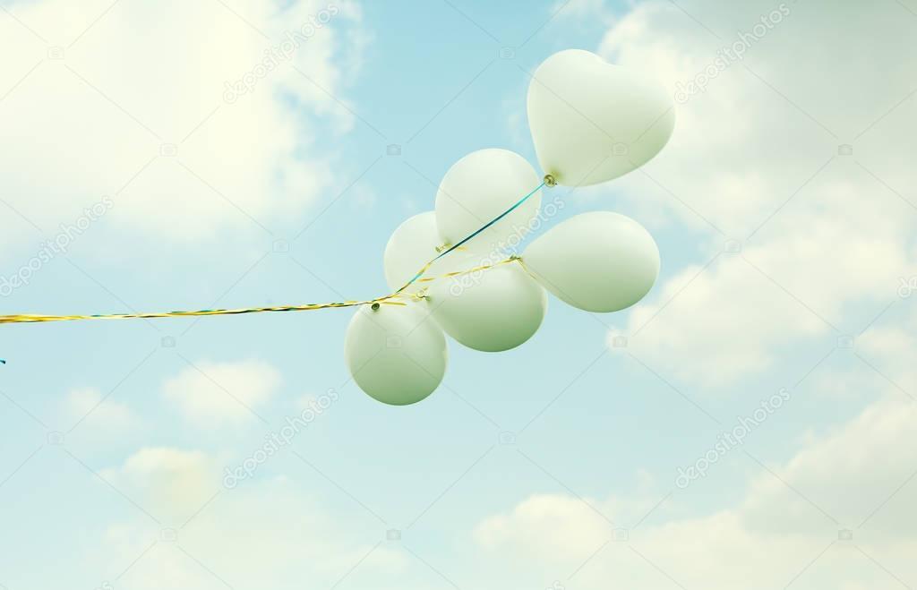 white balloons on blue sky