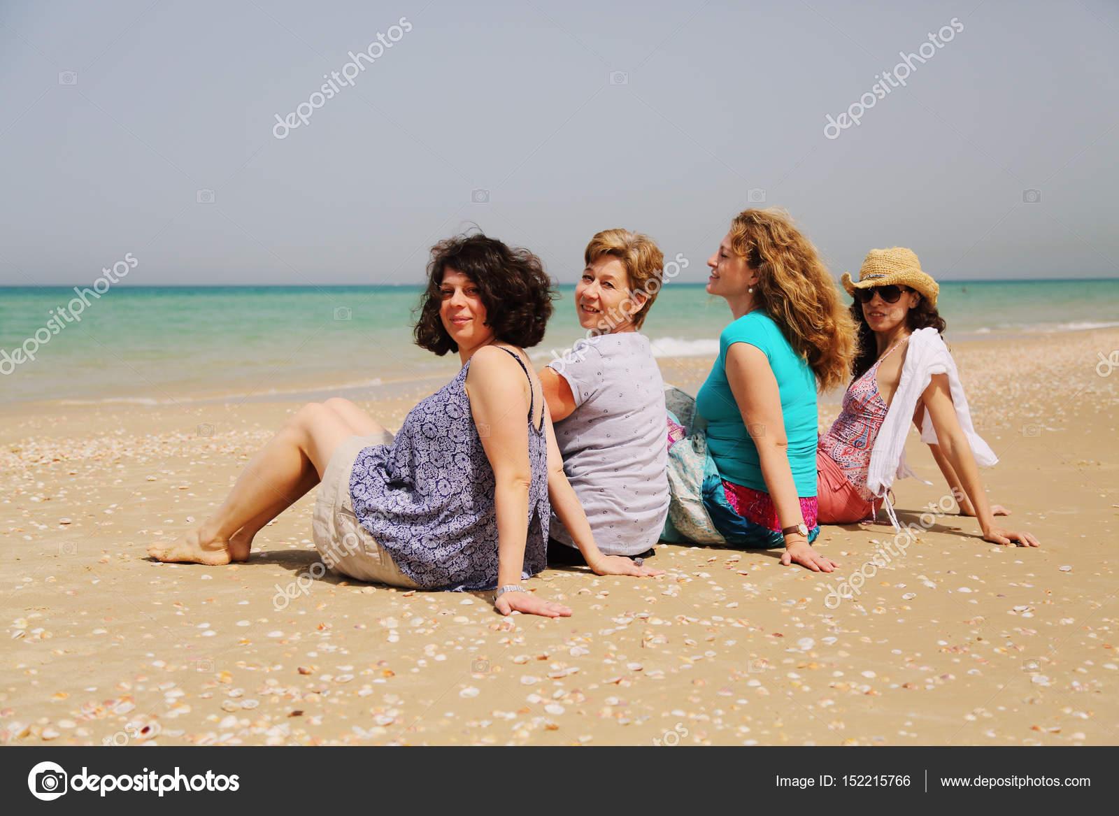 mature women posing on seaside — stock photo © dubova #152215766