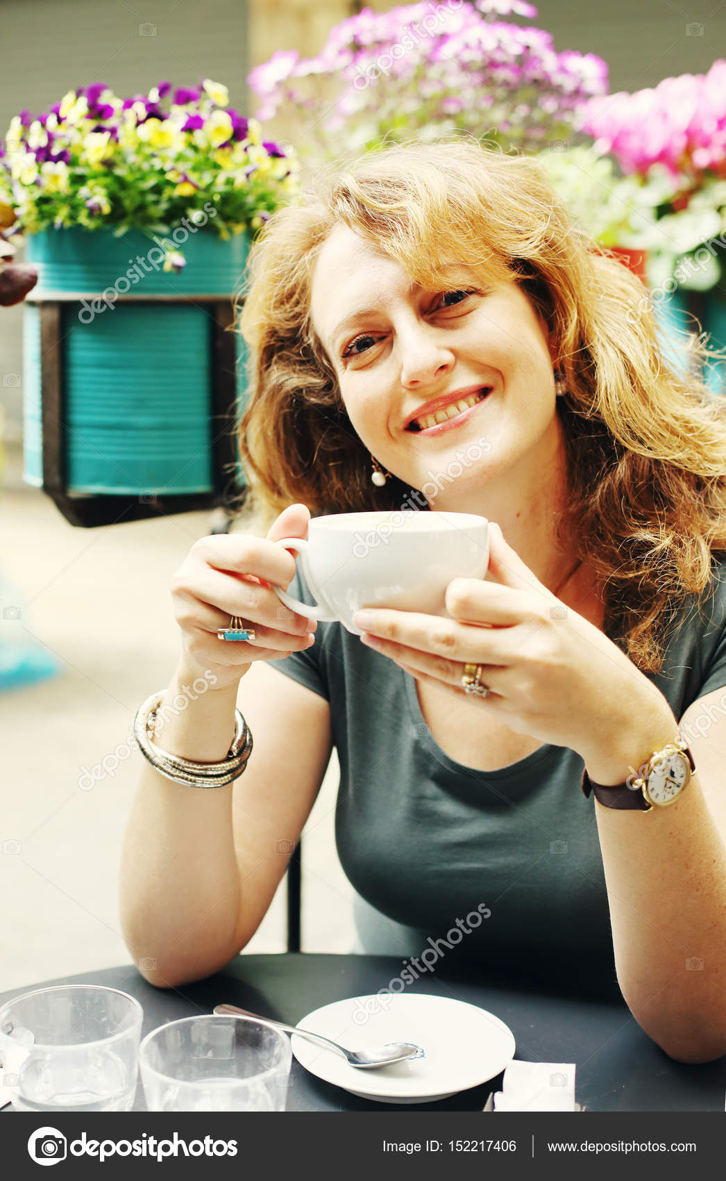 mature woman sitting in outdoor cafe — stock photo © dubova #152217406