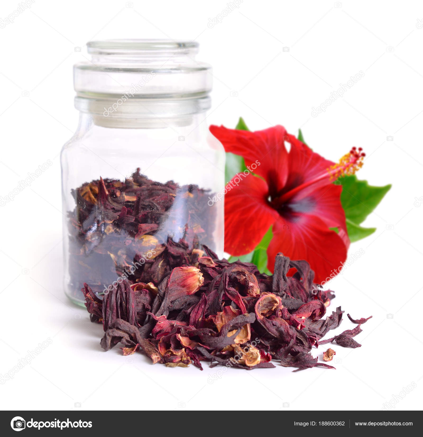 Dry hibiscus tea in glass jar with flower isolated on white bac dry hibiscus tea in glass jar with flower isolated on white bac stock photo izmirmasajfo