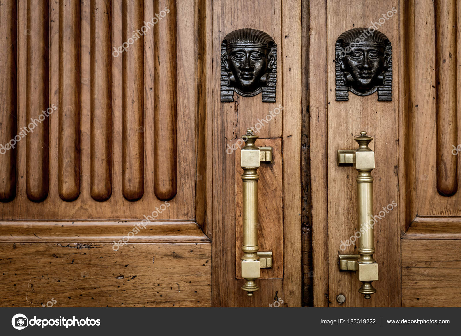 Detail of two bronze Sphinx heads on an old wooden door - around 100 years old Italian palace in North Italy u2014 Photo by perseomedusa & Sphinx heads entrance on wooden door u2014 Stock Photo © perseomedusa ...