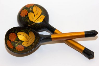 two spoons painted in the style of Khokhloma