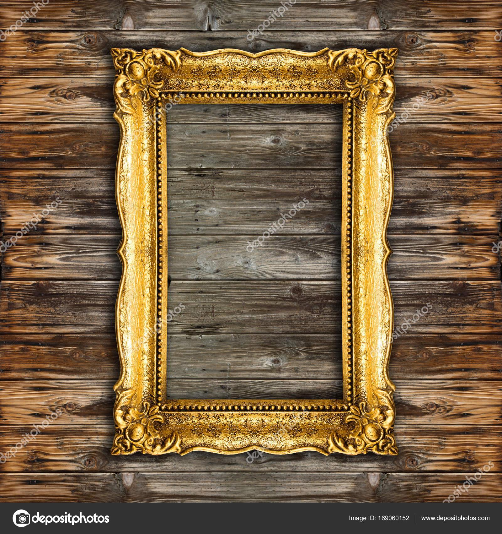 altgold-bilderrahmen auf hölzernen hintergrund — stockfoto © adam_r