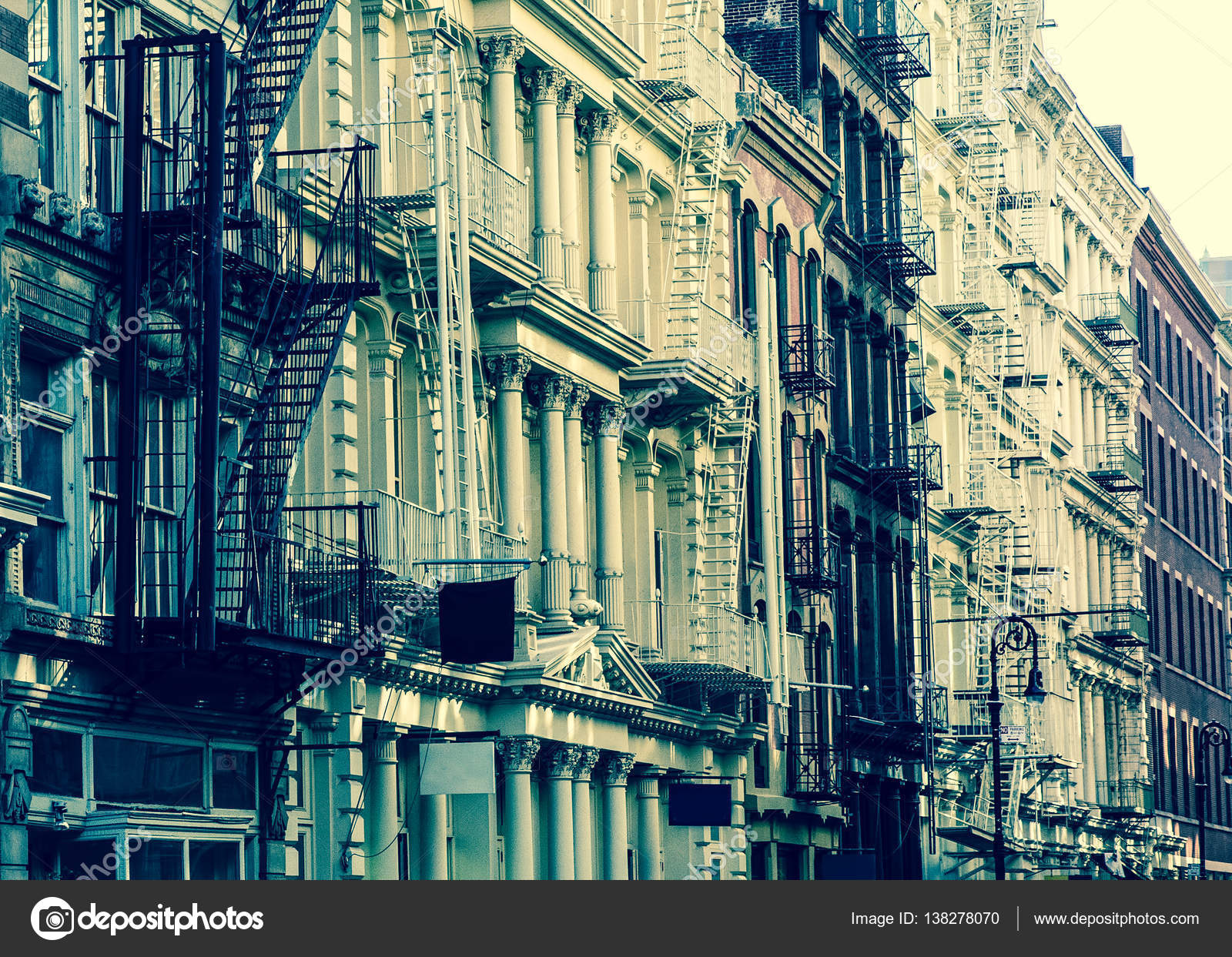 New York City View Of Exterior Facade On Ornate Old Apartment Building Residence With Fire Escapes Seen From Lower Manhattan Vintage Retro Filter