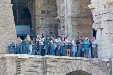 Tourists walk through the building of the Colosseum in Rome