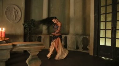 Bellydancer with candles and in beautiful clothes