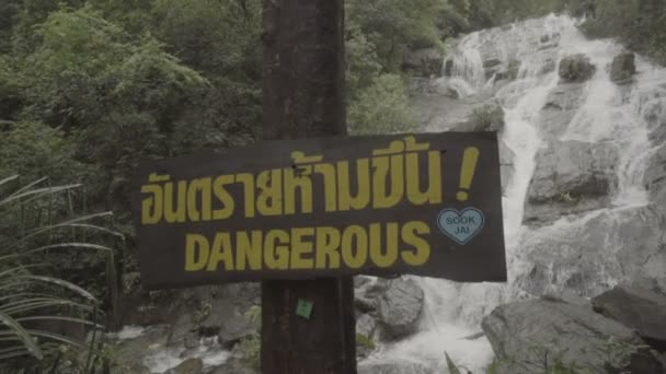 Video of Dangerous sign  over waterfall background