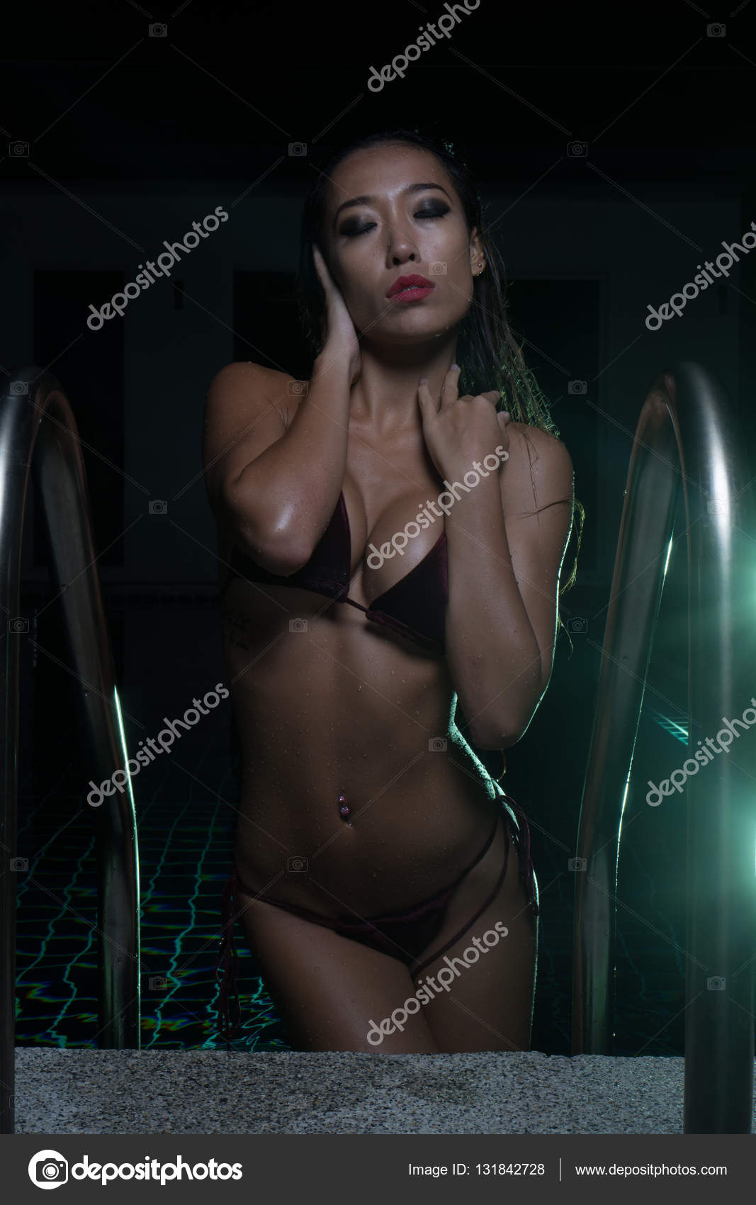 Sexy woman shooting pool