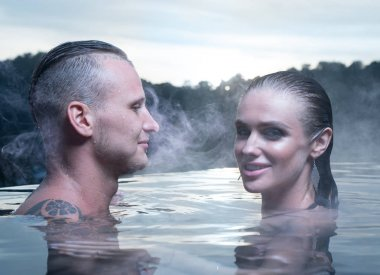 Romantic couple alone in hot outdoor pool