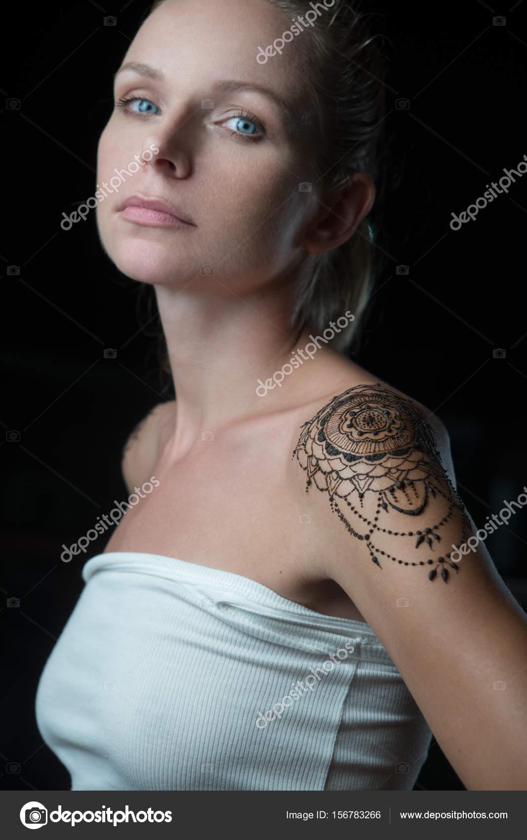 depositphotos_156783266-stock-photo-woman-with-henna-tattoo-on.jpg