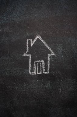 House drawn with white chalk on blackboard stock vector