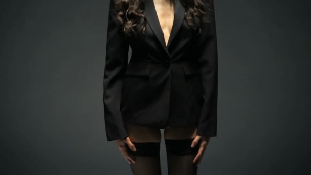 Sexy woman in black blazer and lingerie
