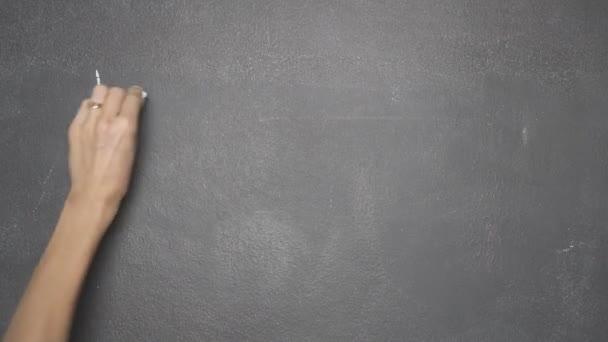 Hand writing LETS TALK on black chalkboard