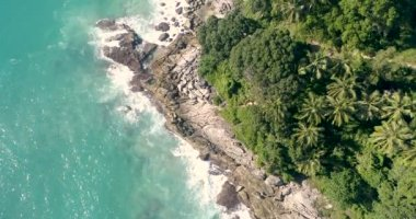 Aerial view of tropical island and sea waves