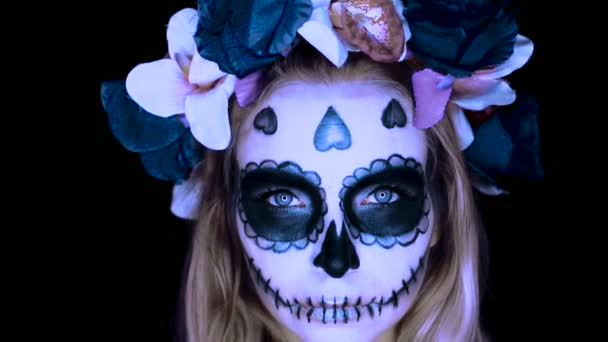 Woman with Mexican sugar skull makeup– stock footage