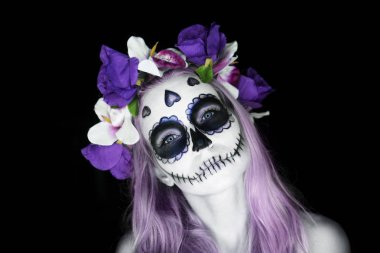 Woman with Mexican sugar skull makeup