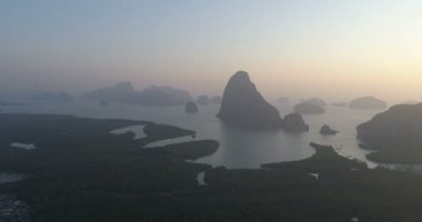 Aerial drone view of sunset at tropical Phang-nga bay in Thailand