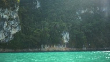 Beautiful view mountain lake and river from boat in Ratchaprapa dam, Khoa Sok National Park, Surat Thani, Thailand - video in slow motion