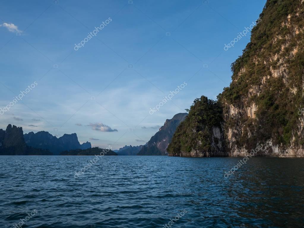 Beautiful view mountains and lake from boat in Ratchaprapa dam, Khoa Sok National Park, Surat Thani, Thailand
