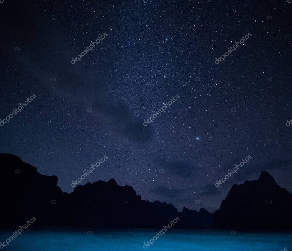 Stars and night sky over lake background