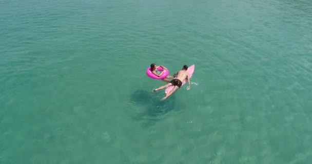 Aerial view of couple enjoying their holidays in amazing clear sea water