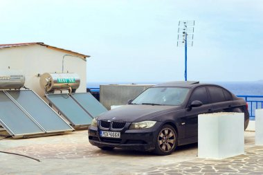 Car BMW parked on embankment. Bali, Crete, Greece