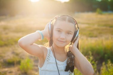 Satisfied girl listening music with headphones