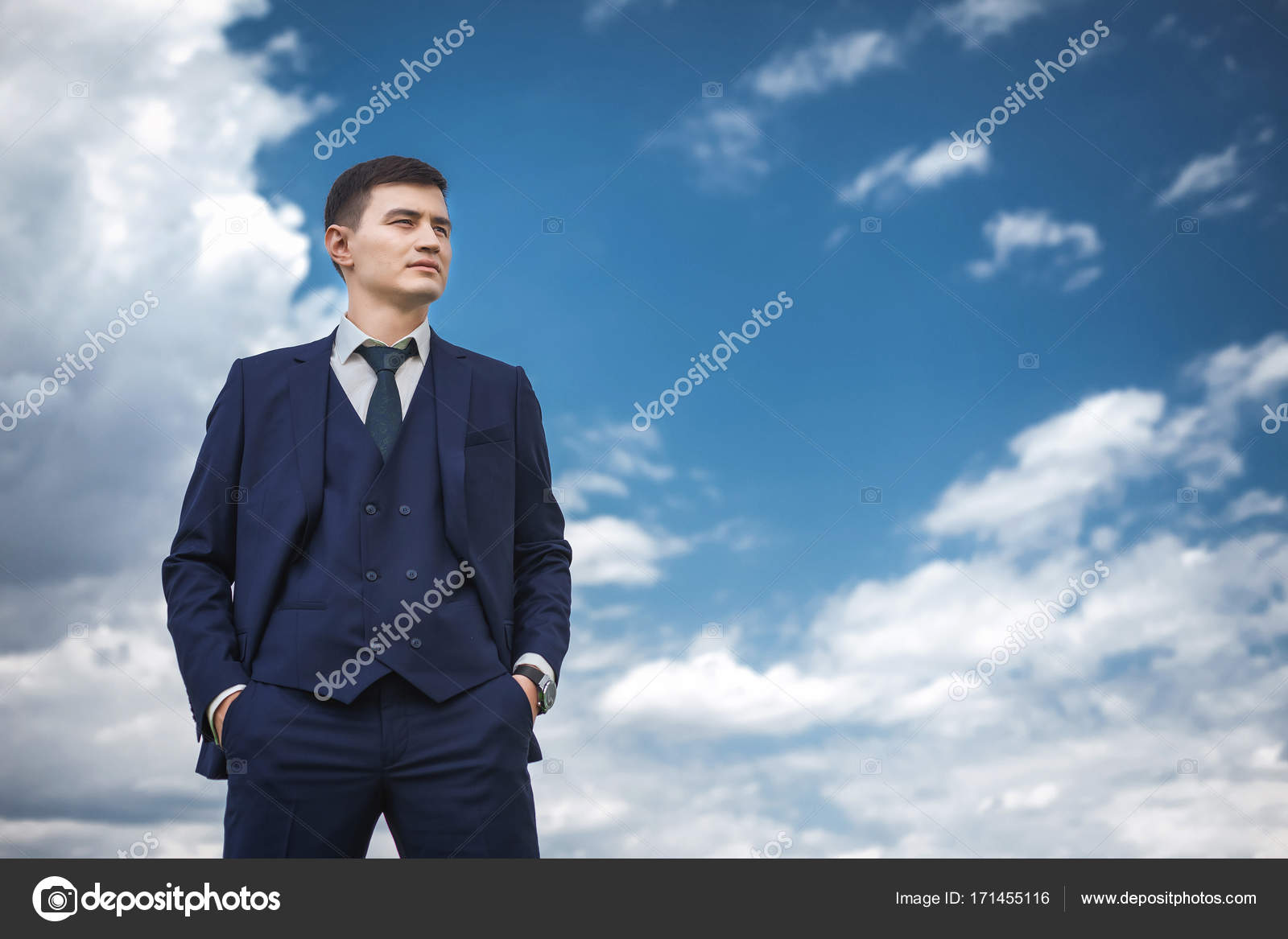Thoughtfull groom in a blue suit smiling in the nature — Stock Photo ...